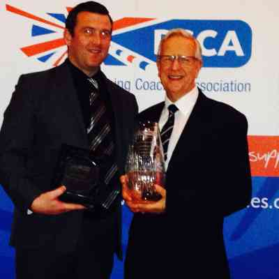 Richard Denigan and Terry Denison holding their coaching awards